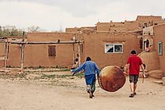 (K. Sawyer Photography) Tags: chile windows men drum adobe hanging carrying taospueblo taosnewmexico redchile taospueblonewmexico