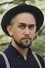 (Carlos M. Boscio) Tags: blue trees portrait man guy green face look hat forest beard eyes woods serious rene amish hazel suspenders boscio