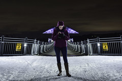 21st Century Guardian (SynOptic Photography) Tags: river old new water sky night white portrait art light snow dog clouds park winter city yellow people bridge model text texting angel footbridge purple wings phone cellphone