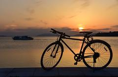 Bike (Yohsuke_NIKON_Japan) Tags: sunset matsue shimane sanin bicycle lakeshinji shinji orange boat lake lakeside 松江 島根 山陰 日本 宍道湖 japan