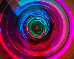 The Watcher (Pixelated Sky) Tags: watching symmetircal tunnel abstract circular jitter intriguing circle magenta blue ocular brightcolours iris eye alien watcher shine blur intentionalblur macromondays
