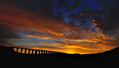 Blazing dawn (images@twiston) Tags: blazingdawn ribblehead viaduct ribbleheadviaduct blazing ablaze fire sky settle carlisle settlecarlisle yorkshire northyorkshire midland railway main line 1875 battymoss battywifehole sebastopol belgravia jericho scheduledancientmonument 24 arch arches ribblesdale dales 3peaks yorkshire3peaks penyghent parkfell golden morning national park yorkshiredalesnationalpark moorland moor blue sunrise dawn clouds yellow orange red burning silhouette silhouettes silhouetted landscape imagestwiston twentyfour fells shadow shadows sweeping curve curved wideangle ultra wide angle ultrawide darkarches godsowncountry