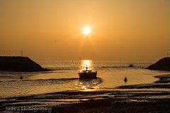 As the fishing boat meets the sun (judethedude73) Tags: morning sunday sun sunrise sky sussex sunrisephotography water coast boats eastbourne light refletion fisherman