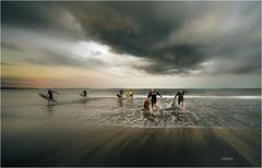 Someone Said Shark (elpedro1960) Tags: seascape auckland newzealand surfer swimmer shark mairangi bay sky clouds water beach