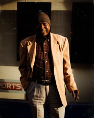 Sharif (C.Preston Roberts) Tags: cigarette smoking smoker cap beanie person warmth warm emotion humour laughing laugh happiness happy streetstyle street suit goldenhour sun man