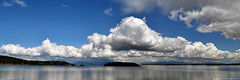 2017-04-15 Padilla Bay Panorama (3072x1024) (-jon) Tags: anacortes skagitcounty skagit washingtonstate washington pacificnorthwest pnw spring salishsea fidalgoisland sanjuanislands pugetsound guemeschannel fidalgobay padillabay seascape landscape pano panorama panoramic sky cloud clouds islands composite stitched a266122photographyproduction guemesisland hatisland saddlebagisland cumulus