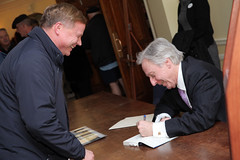 Signing books after lecture