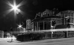 Library (parasomnist) Tags: road street city shadow night dark outdoors evening spring dusk streetlamps streetlights library sheffield yorkshire headlights lensflare midnight crookes starbursts walkley