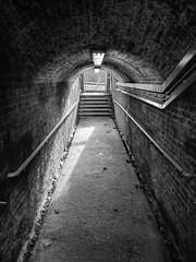 Lee station underpass (Spannarama) Tags: uk light blackandwhite sunlight brick london station stairs underpass arch shadows lee passage handrails