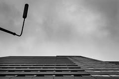 Looking Up (Thomas TRENZ) Tags: vienna wien sky bw white black lamp austria lampe nikon streetlight iso400 himmel sw weiss schwarz towerblock hochhaus 18mm f35 12000 ãsterreich nikon1855mm3556vr nikond5100 straãenbeleuchtung