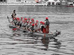 Dragon boats on Vltava (Jessica Lindner) Tags: city red race boats republic dragon czech prague capital caps czechrepublic vltava