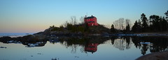 Marquette lighthouse (yooperann) Tags: red lighthouse lake ice reflections evening memorial day dusk weekend michigan may superior sunny cover shore marquette mccartys