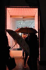 brella scene (dalioPhoto) Tags: street city nyc pink urban newyork rain silhouette vertical night digital umbrella lights nikon manhattan soho entrance doorway storefront raining d700 daliophoto marcdalioall