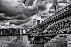 Over the Thames from Southwark (David Feuerhelm) Tags: nikkor blackandwhite bw noiretblanc nb contrast riverthames atmosphere bridge arches architecture buildings cityscape city london england sky clouds nikon d7100