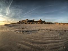 Bamburgh Castle at dawn - Wide (neilalderney123) Tags: ©2017neilhoward samyang fishie fisheye beach sand bamburgh castle landscape olympus omddawnsunrise