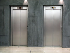 elevators (JR One Lifts) Tags: elevator elevators lift floor silver close closed sliding door building transfer wait waiting steel transportation up down metal architecture cities direction doorways entrances metallic modern nobody paneling possibility rectangle sheet shiny stainless wall two republicofmontenegro suppliers manufactures