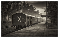 The Departing Train (Kam Sanghera) Tags: black bw white india punjab panjab bilga station train indian railways platform nik efex silver canon eos 5d mark ii ef24105mm f4l is usm ef 24105 mm f4 l landscape