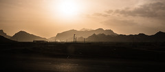 Lone road (\Nicolas/) Tags: road route iran iranian plateau mountain sun sunset gaz sky desert