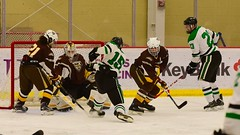 jammed up... (R.A. Killmer) Tags: sru ice hockey skate skill stick hits shot puck acha green white college competition gritty