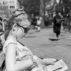 Girl reading in Union Square, NY (FourteenSixty) Tags: bokeh park sunglasses newyork nyc unionsquare blackwhitephotos monochrome manhattan