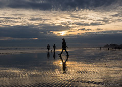 Striding (Sue MacCallum-Stewart) Tags: brighton lowtide sunset sand reflections seascape coast figures striding landscape