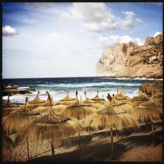 The Hut (Helldorado Berlin) Tags: hipstamatic janelens dcfilm tiki parasol beach baleares spring ocean waves clinds mountains cliff spain mallorca balearic