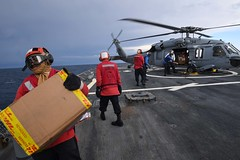 Sailors assigned to USS Porter unload supplies from an MH-60S Sea Hawk helicopter. (Official U.S. Navy Imagery) Tags: ussporterddg78 ghostriders mh60s seahawk helicopter mediterraneansea