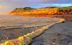 I'm still  RUNNING...... (Lani Elliott) Tags: lanielliott lani elliottlani nature naturephotography sky skies cloud clouds beach sand sea ocean sunset light bright glowing radiant seafoam australia tasmania strahan oceanbeach