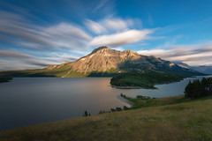 Waterton Lakes National Park, Alberta Canada (Explore - Best Position #17 - April 19, 2017) (Brian Krouskie) Tags: waterton lakes national park prince wales hotel lake clouds sky mountain field grass flower trees outdoor landscape longexposure alberta canada explore