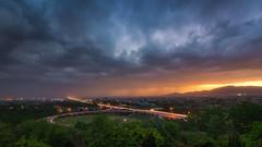 Raining Sunset in Islamabad (hamzaqayyum) Tags: sunset clouds raining rain overcast light trails longexposure wideangle landscape islamabad pakistan tokina orange city