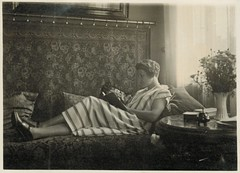 Reading in comfort (sctatepdx) Tags: germany snapshot vernacular vintagedress womanreading oldsnapshot vintageinterior vintagesnapshot vintagewomanreading