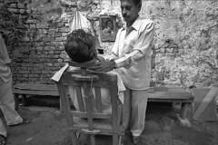 India - Kolkata (luca marella) Tags: street city portrait people blackandwhite bw white black film analog blackwhite voigtlander bessa documentary social pb bn shaving barber bianco nero cultural marellaluca
