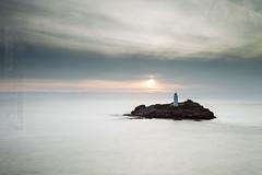 Island sunset (Simon Bone Photography) Tags: longexposure sea sky cloud sun lighthouse mist beach silhouette island sand cornwall waves le milky godrevy cornishcoast cornishsunsets canonef1740mmlf4 canoneos5dmkii hitechnd09reversegrad wwwsimonbonephotographycouk hitech6stopirnd