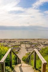 (Jay.Garcia) Tags: ocean sunset cloud sun west beach clouds stairs landscape log sand rocks stair arch horizon stairway driftwood walkway handrail aile ailes