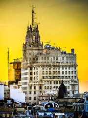 Sunset over the Art-Deco Telefnica headquarters building on Gran Via viewed Bellas A