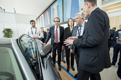 Helmut-Joseph Schramm (r) showing the BMW i8 to Alexander Dobrindt and Frédéric Cuvillier during the VIP Exhibition Walk-around