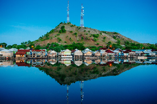 Reflection of Poto Tano Stilt Houses