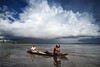 Amazon (Mathijs Buijs) Tags: old woman cloud storm man peru america canon river eos boat amazon rainforest couple village south wideangle basin canoe elderly jungle 7d rowing canoeing distance paddling oran peruvian