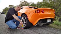 IMG_20140524: Fixing A Flat (i_am_lee_sam) Tags: orange highway flat lotus elise tire