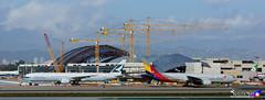 Cathay Pacific B777-300ER & Asiana Airlines B777-200ER (Skyler Mao) Tags: ana losangeles eva emirates korean cal a380 lax wynn raytheon westjet chinaairlines voodoo lexus a320 aeroflot a319 evaair losangelesinternationalairport deltaairlines b747400 b767300er b767200er