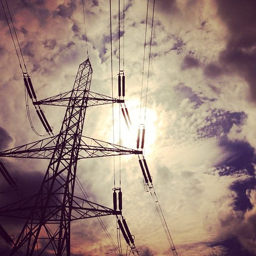 An #electrical #high #sky #up #pylon #skyhigh #aphotoangel #electric #lookup #charging #current #metal #grey #sunny #cables #cloudy #golden #white #fluffy #electricpylon #blue #hum #gray #sunlight #weather #instaweather #cloudbreak #lines #pattern #sunli