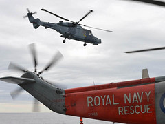 A Wildcat helicopter operates from HMS ILLUSTRIOUS (Royal Navy Media Archive) Tags: aircraftcarrier wildcat lynx atsea illustrious peopleatwork firstlanding homewaters surfaceship 700wnavalairsquadron