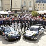 2014- Le Mans- Scrutineering- Dempsey Racing-Proton Porsche 911 RSR Team Image