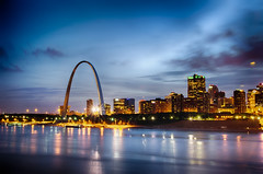 City of St. Louis skyline. Image of St. Louis downtown with Gateway Arch at twilight. (AgFineArtPhotography.com) Tags: city blue sunset sky copyright usa reflection green monument water skyline architecture night skyscraper river illinois twilight streetlight cityscape arch waterfront purple dusk stlouis arc citylife nobody illuminated fisheye missouri gatewayarch mississippiriver tall copyrighted urbanscene traveldestinations famousplace buildingexterior midwestusa builtstructure