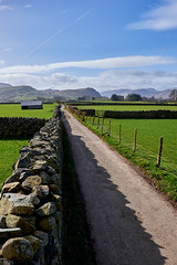 long road (scottprice16) Tags: england cumbria road straight sun spring march hills fells farm lake lakedistrict landscape wall drystonewall keswick castlerigg castleriggstonecircle history fujixt1 18135mm barn