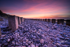 Groynes on Murlough Beach. Newcastle, Northern Ireland. (jtat_88) Tags: 12neutraldensityveryhardgrad 2017 amateur antilandingobstacles beach clouds coast contrast countydown decay defence digital dundrumbay filters fullframe goldenhour groyne horizon ilce7 ireland lee leefilters leelandscapepolariser landscape march mirrorlesscamera murlough murloughnationalnaturereserve nationaltrust nature neutraldensity newcastle northernireland pattern pebbles perspective posts reach rocks rotten sel1635z sand scenic sea seascape seaweed shingle shore sky sony sony1635mmf4variotessartfezaoss sonya7 sunrise wwii wideangle wooden zeiss unitedkingdom gb