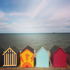 Huts of colour (vapour trail) Tags: whitstable kent coast town seaside beach huts wood colour horizon sea