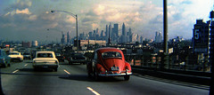 Cruising the highways of Brooklyn in my dad's 1953 Pontiac Chieftan. Old brownstowns on the street at right and the towering skyline of Lower Manhattan in the distance. New York. Aug 1969 (wavz13) Tags: oldphotographs oldphotos 1960sphotographs 1960sphotos oldphotography 1960sphotography vintagephotographs vintagephotos vintagephotography filmphotos filmphotography newyorkphotographs newyorkphotos oldnewyorkphotography oldnewyorkphotos vintagenewyork vintagemanhattan vintagenewyorkphotography vintagenewyorkphotographs vintagenewyorkphotos 126film squareformat instamatic grain grainy vintagekodachrome oldkodachrome vintagecars vintagecar oldcar oldcars 1960scars collectiblecars collectablecars manhattanskyline newyorkskyline newyorkskyscapers manhattanhistory newyorkhistory volkswagenbeetle oldvw vintagevw oldbeetles vintagebeetles oldchevies oldchevy vintagechevynova oldchevynova oldhighways vintagehighways oldbrooklyn vintagebrooklyn 1960sbrooklyn oldbuildings vintagebuildings vintagelicenseplates oldlicenseplates