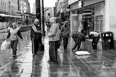 Spice 5 - Dealers and Users (_p_e_r_s_e_p_h_o_n_e_) Tags: manchester uk monochrome sidewalk people rain metrolink persephone spice spicedrug homeless addicts dealers