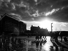 ** (donvucl) Tags: london kingscross granarysquare sky clouds reflections shadows figures buildings fountain blackandwhite bw olympusem1 donvucl street